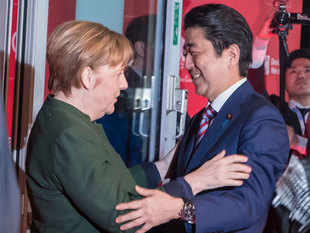 German Chancellor Angela Merkel (Left), greets Prime Minister of Japan Shinzo Abe, in Hanover, Germany. (File photo)