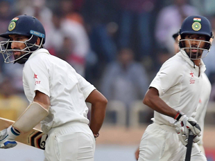 Cheteswar Pujara and Wriddhiman Saha cross each other to complete a run during 4th day of 3rd Test Match against Australia