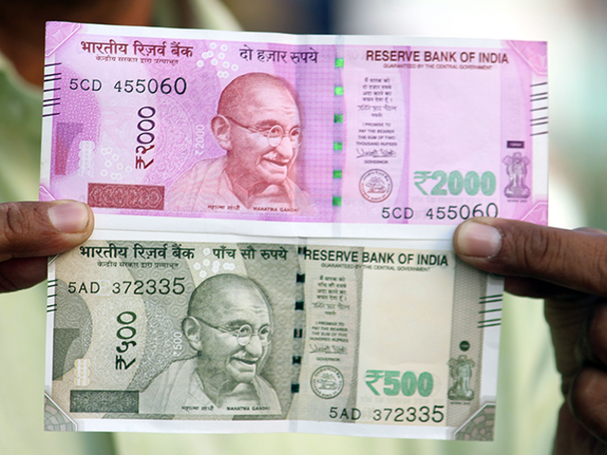 Rupee opens nearly 4 paise down at 65.40 against dollar