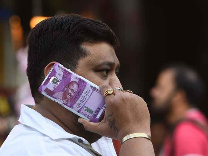Rupee snaps 2-day fall; up 11 paise at 65.41 against dollar