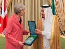 Saudi King Salman, right, presents a gift to British Prime Minister Theresa May, in Riyadh, Saudi Arabia, Wednesday.