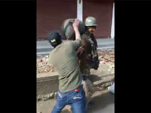 Shot of a video of a jawan being beaten by a local. The jawan was present with other jawans.