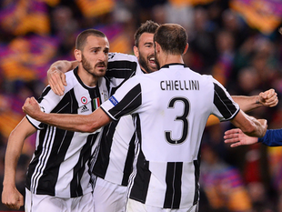 Giorgio Chiellini (R) celebrates their qualification with teammates at the end of the UEFA Champions League quarter-final second leg football match.