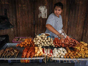 Bangkok is often voted the world's best destination for street food in travel polls. Residents and visitors throng to the makeshift restaurants, often with plastic stools.