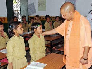 Uttar Pradesh Chief Minister Yogi Aditiyanath during a visit in school of Jhansi on Thursday.