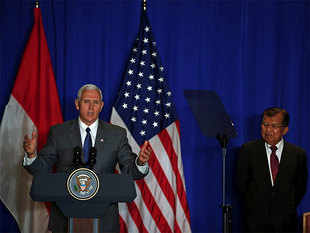 US Vice President Mike Pence delivers a speech as Indonesian Vice President Muhammad Jusuf Kalla listens at a business forum in Jakarta.