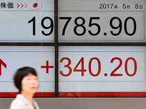 Tokyo stocks opened higher Wednesday as the yen remained relatively weak.