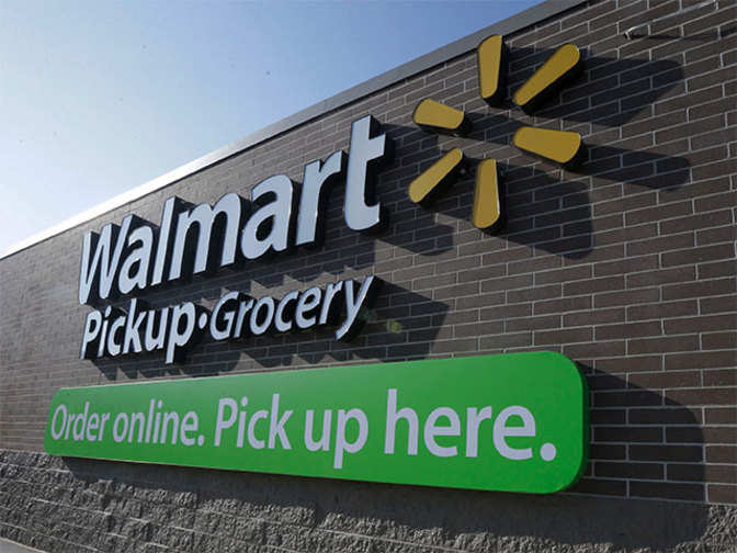 Wal-Mart earnings dip but sales rise at US stores