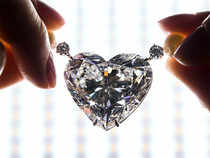 In this file photo, the flawless heart-shaped Boehmer and Bassenge 'La legende' diamond is displayed during a preview at Christie's, in Geneva, Switzerland.