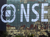 NSE Nifty index was trading 21.60 points down at 9407 at 1.15 pm (IST).