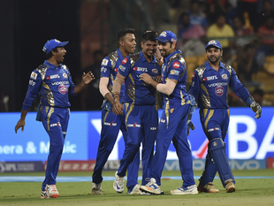 Mumbai Indians Karn Sharma, centre, celebrates the wicket of Colin De Grandhomme of Kolkata Knight Riders with his team players during the Indian Premier League cricket eliminator match in Bangalore.
