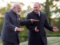 Prime Minister Narendra Modi, left, and Russian President Vladimir Putin talk to each other as they walk at the St. Petersburg International Economic Forum in St. Petersburg, Russia, Thursday, June 1, 2017.