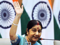 """India didn't sign the Paris climate deal under pressure or greed for money,"" Swaraj told reporters."