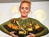 This file photo taken on February 12, 2017 shows Adele as she poses in the press room with her trophies, including the top two Grammys of Album and Record of the Year for her blockbuster hit 'Hello' and the album '25', during the 59th Annual Grammy music Awards in Los Angeles, California.