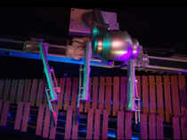 Shimon, with four arms and eight sticks can play harmonies and chords on marimba.