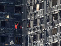 Members of the emergency services work inside burnt out remains of the Grenfell apartment tower in North Kensington, London, Britain.