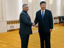 Minister of State for External Affairs General V K Singh shake hands with Chinese President Xi Jinping at Beijing on Monday.