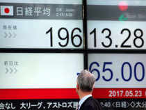 Japan's Nikkei rose more than 1 per cent to hit a near two-year high on Tuesday following a rebound in US hi-tech shares.