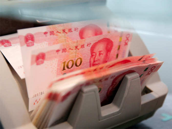 China's yuan again slightly weakens, corporate dollar demand strong