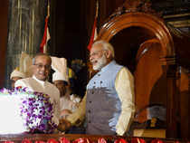 President Pranab Mukherjee and Prime Minister Narendra Modi shake hands after the launch of 'Goods and Services Tax (GST)', at the special ceremony in the Central Hall of Parliament in New Delhi on Saturday.