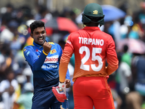 Sri Lanka's Wanidu Hasaranga (L) celebrates after he dismissed Zimbabwe's Donald Tiripano (R) during the second one-day international (ODI) cricket match between Sri Lanka and Zimbabwe