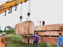 File photo of unloading of stones for the construction of Ram Jambhoomi temple at Ram Sewak Puram, VHP's temple workshop in Ayodhya.