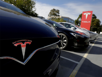 Tesla shares fell as much as 4.4% and traded down 3.3% to $317.10 as of 11:36 am in New York trading.