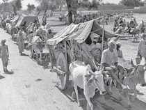 People travelling on bullock carts and on foot, following Partition, October 1947.