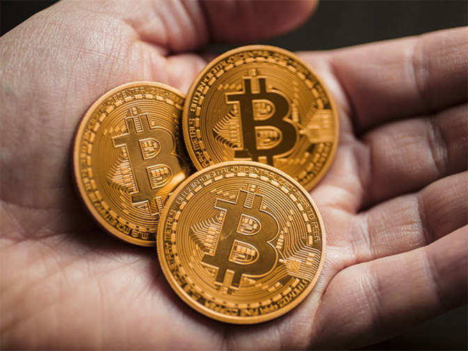 India: With attacks soaring, India races to regulate cryptocurrencies - Economic Times