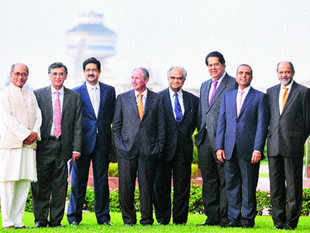 STANDING TALL: (L-R) Digvijaya Singh, Harish Manwani, Kumar Mangalam Birla, Stephen Schwarzman, Ram Charan, K V Kamath, Sunil Mittal and Adil Zainulbhai<hr><a href=&quot;/articleshowpics/6703172.cms&quot;>The Winners of the ET Awards 2010</a>