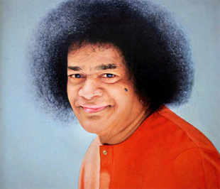 A portrait of Sri Sathya Sai Baba, who died in the age of 86 in Puttaparthi, Andhra Pradesh on Sunday. (PTI Photo)