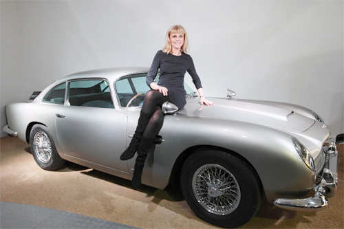In this file picture taken on January 15, 2012 Swedish actress Britt Ekland poses for photographers on the Aston Martin DB5 car used in the 1964 James Bond film 'Goldfinger' on display during a press preview of the Bond in Motion exhibition at the Beaulieu National Motor Museum at Brockenhurst in the southern English county of Hampshire. (AFP)