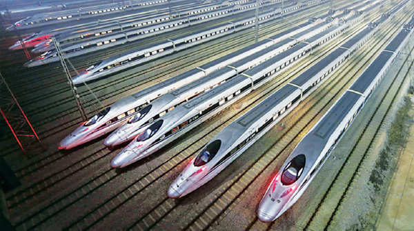 CRH380 Harmony bullet trains are seen at a high-speed train maintenance base in Wuhan, China.