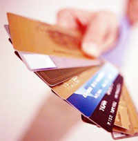 Credit card cos take cash crunch head-onCredit card cos take cash crunch head-on