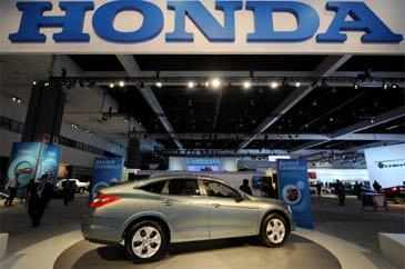 Honda Motor Co's operating profit rose less than expected in the April-June period to $2.25 billion, as a strong yen eroded some of the gains.