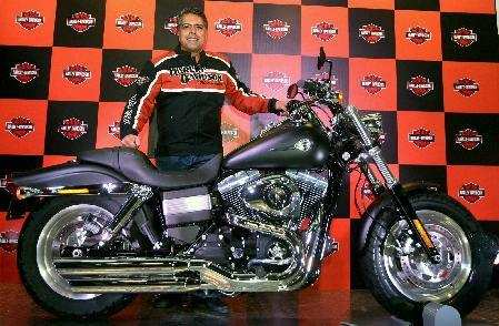 Anoop Prakash, Managing Director, Harley-Davidson India, poses with the Fat Bob motorcycle during its launch in New Delhi on Thursday.Photo by Kamal Singh