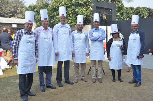 CEOs take time off, cook for a good cause