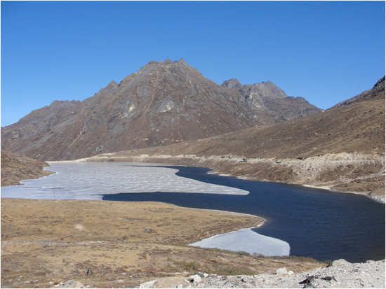 Icy lake at Sela Pass