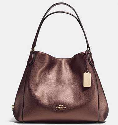 512d8ab66f Amidst slump, Michael Kors, Prada cut back on innovative bag designs