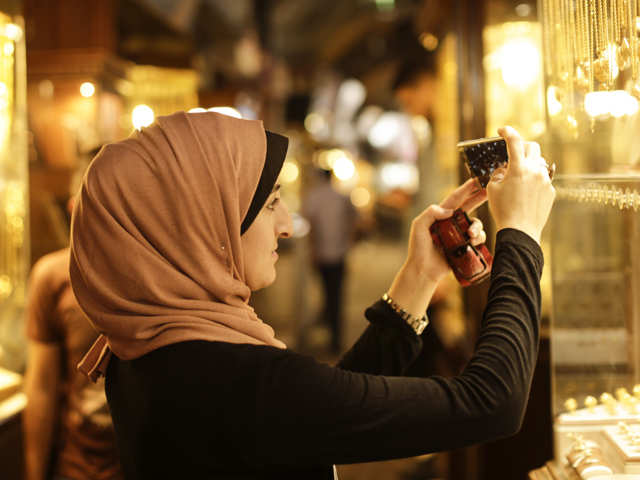 Two Palestinian girls show a different side to Gaza with a phone in their hand