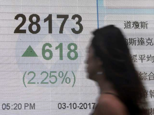 S.Korean stocks at record high as cbank raises growth outlook, won edges up thumbnail