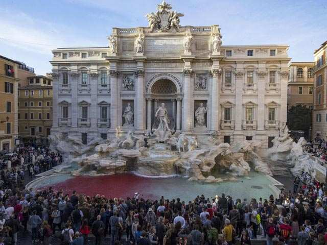 Rome's iconic Trevi Fountain runs red after activist dyes it in protest