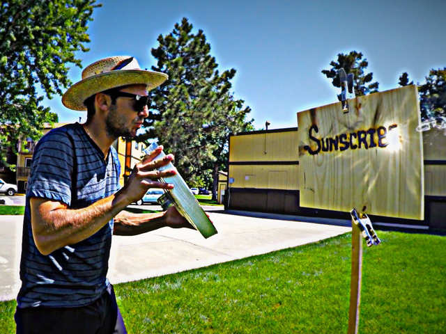 Meet Michael Papadakis, an artist who uses sun and magnifying glass to paint