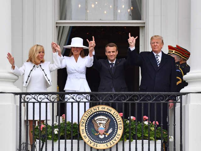 A special relationship: Donald Trump flicks 'dandruff' off Emanuel Macron's suit