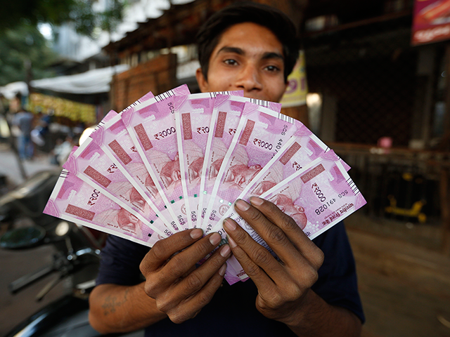 Rupee falls 12 paise to close at fresh 16-month low