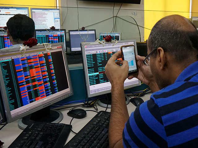 Sensex falls 100 points on trade war concerns, Nifty below 10,800