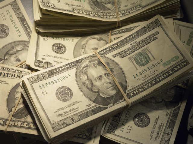 Dollar holds near 13-month peak as emerging market peers wobble thumbnail