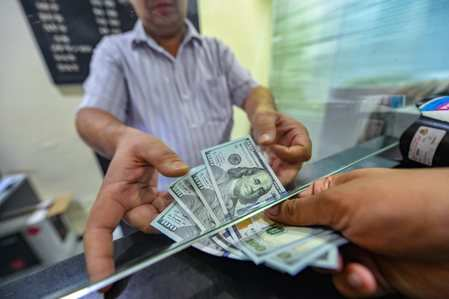 Rupee up 5 paise on trade deficit cheer