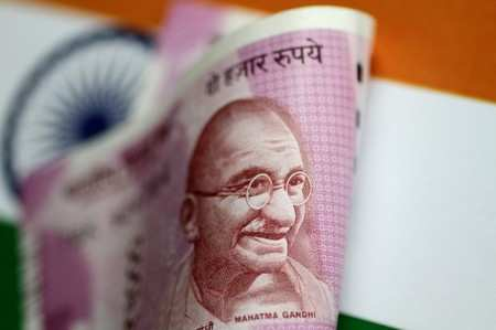 Rupee opens 14 paise up at 71.10 vs dollar