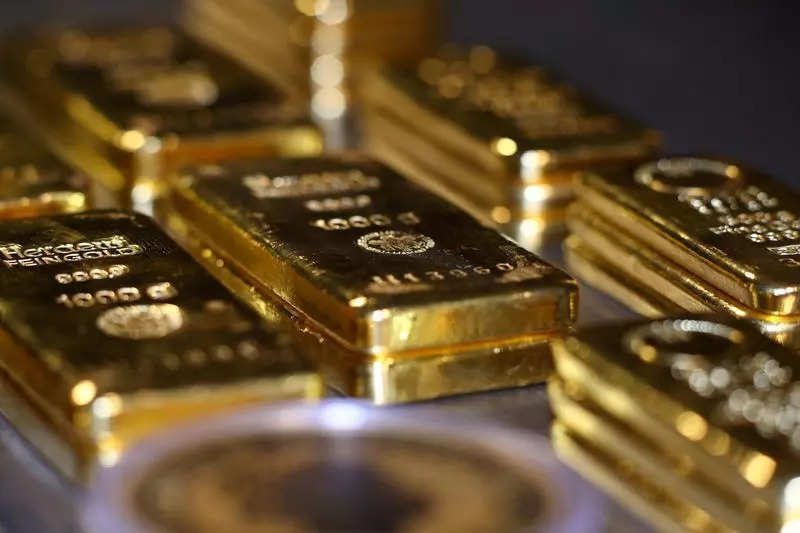 Gold rises, set for weekly gain on softer dollar